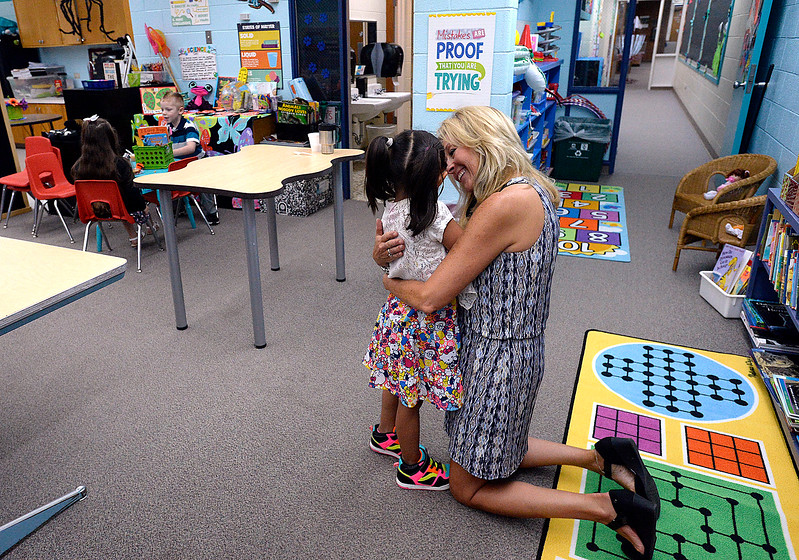 Teacher Karey Thomas comforts kindergartener Jenevy Rodriguez, 5, Friday, Aug. 18, 2017, on the first day of school in Loveland.   (Photo by Jenny Sparks/Loveland Reporter-Herald)
