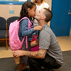 Harmony Pinault, 6, gives her dad Louis a kiss just before heading off to start the first grade on the first day of school at Crocker Elementary School in Fitchburg Thursday. SENTINEL & ENTERPRISE/JOHN LOVE