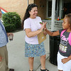 Amaidi Melendz, 10, gets greeted by Crocker Elementary School Vice Principal Casey Beaulac and art teacher Andres Ouellette as she gets ready to start the fourth grade on September 1, 2016 in Fitchburg. SENTINEL & ENTERPRISE/JOHN LOVE