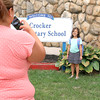 Cheryl Lemay takes a picture of her daughter Sophia Otero, 7, just before she headed off to start the second grade at the Crocker Elementary School on Thursday Stempber 1, 2016. the first day of School in Fitchburg. SENTINEL & ENTERPISE/JOHN LOVE