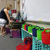 Crocker Elementary School fourth grade teacher Michele Duprey gets her classroom ready on the first day of school in Fitchburg just before all the students started to arrive. SENTINEL & ENTERPRISE/JOHN LOVE