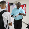 Fitchburg High School employee Thomas Hughes with student support helps out a new student find his classroom on the first day of school on September 1, 2016. SENTINEL & ENTERPRISE/JOHN LOVE