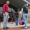 Fitchburg High School Assistant Principal Tom DiGeronimo greets students on the first day of school as they get oof the bus on September 1, 2016. SENTINEL & ENTERPRISE/JOHN LOVE