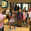 Crocker Elementary School Principal Adam Renda onright helps Abscelyn Figueroa and her kids fourth grader Abscelyn, 9, and second grader Eliesel Figueroa, 7, on the first day of school in Fitchburg on September 1, 2016.
