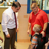 Crocker Elementary School Principal Adam Renda chats with new first grader James Blanchard III on the first day of the 2016-17 school year. With him is his dad James Blanchard,  sister Jordan Blanchard, 9 on left, and his brother jacob Blanchard, 3, just behind him. SENTINEL & ENTERPRISE/JOHN LOVE