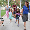 Cousins Ella Comeau, 8, and GAbriella Berberian, 8, are all smiles as they get to the Crocker Elementary School on Thursday to start their first day of the third grade. with them is from left in the back is Stephanie Comeau, Robert Berberian and Lorena Berberian, holding Gabriella's hand. SENTINEL & ENTERPRISE/JOHN LOVE
