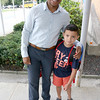 Fenley Sylvain gets a picture taken with his son Alexzavian Sylvain, 6, just before he headed into the Crocker Elementary School for his first day of the first grade. SENTINEL & ENTERPRISE/JOHN LOVE