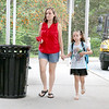 Jen Darmanin walks her daughter Evelyn Darmanin, 7, now a second grader to school at the Crocker Elementary School on Thursday as the new school year starts in Fitchburg. SENTINEL & ENTERPRISE/JOHN LOVE
