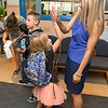 Sam Squailia says good by to her daughter Niki Squailia, 6, as she heads off to her first day of the first grade at the Crocker Elementary School in Fitchburg. SENTINEL & ENTERPRISE/JOHN LOVE