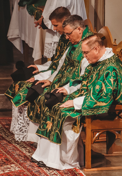 FSSP LatinMass St  Marys 3 priest sitting-1