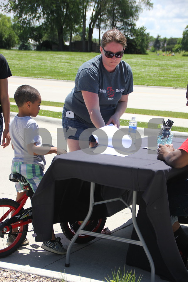 Fort Frenzy held their first  Pedal Parade on Sunday, June 7, 2015, at the Fort Frenzy parking lot . Shown here is the first  participant to arrive at the event as they  check in and  get registered. They are (left to right): Amari McCaleb and Tricia McCaleb.