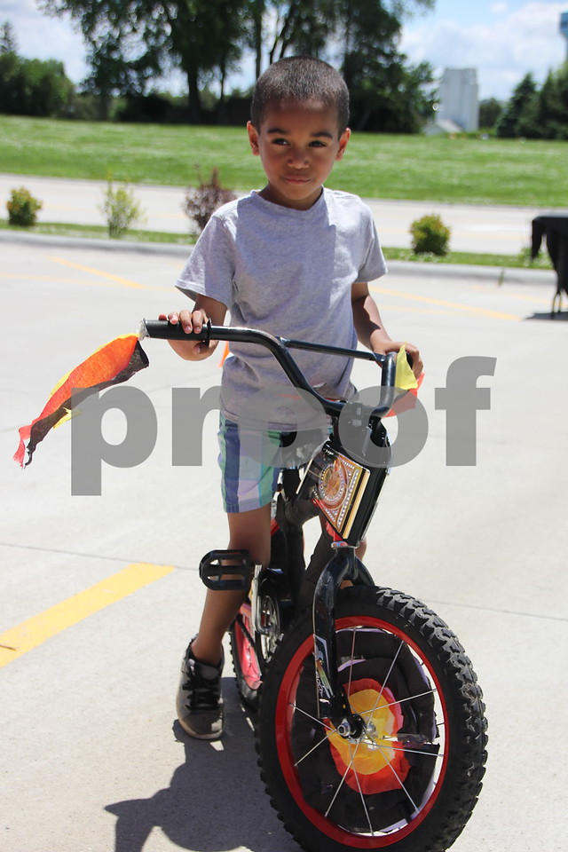 Amari McCaleb with his  prize winning decorated bike. He was a participant in Fort Frenzy's first Pedal Parade that was held in the parking lot of Fort Frenzy on Sunday, June 7, 2015.