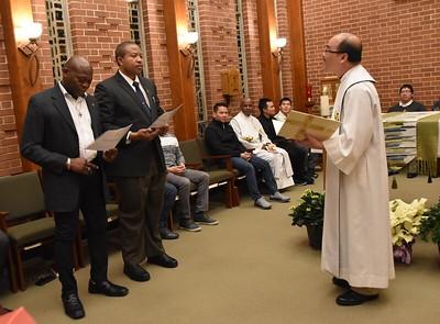 Fr. Quang, filling in for Fr. Ed Kilianski, receives the postulants