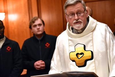 Fr. Ed proclaims the Gospel