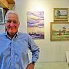 I saw George Dawson at his art studio in Riverviews Artspace. He is standing next to his beautiful oil paintings.