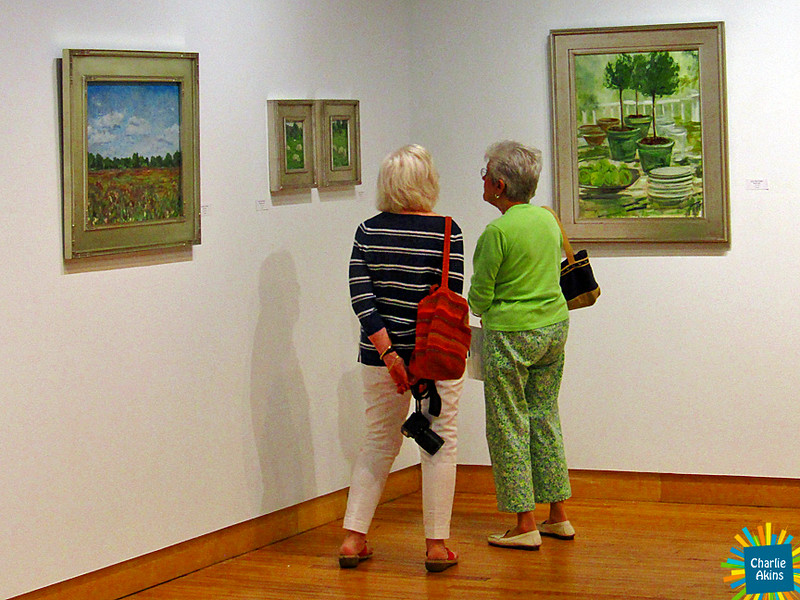 These ladies admire artwork at the Academy Center of the Arts.