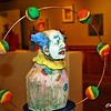 There is an exhibit of clown art at Riverviews Artspace.