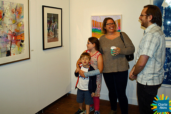 This family is enjoying the art gallery.