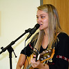This young lady sang and played the guitar