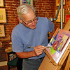 George Dawson was painting in his studio at Riverviews Artspace.