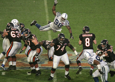 Indianapolis Colts' DE Robert Mathis (98), soars towars Chicago Bears' QB Rex Grossman (8) in the 4th Quarter. Indianapolis Colts versus the Chicago Bears in Super Bowl XLI at Dolphins Stadium in Super Bowl XLI, Miami, Fla., on February 4, 2007. (Sam Riche / The Indianapolis Star)