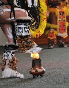 A dancer of the Tloko-Nahuake Traditional Aztec troupe performs a Fire Dance at the 36th Annual Miccosukee Indian Arts Festival.
