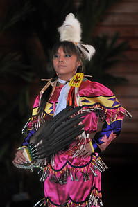 "A Navajo dancer from the Monument Valley Dancers in her ""jingle dance"" dress.  35th Annual Miccosukee Indian Arts Festival."