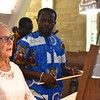 Our organist, Diane Skobis, gets a few pointers on Togolese music