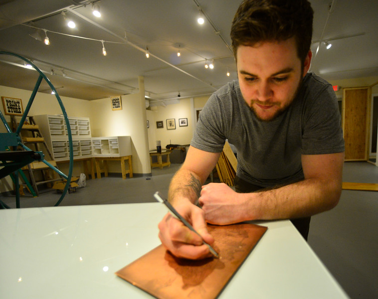 KRISTOPHER RADDER — BRATTLEBORO REFORMER<br /> Daniel Chiaccio, owner of First Proof Press, prepares to open his print shop in the former Mitchell Giddings Gallery space after Mitchell Giddings moved into a new space on Main Street, in Brattleboro. The first class in this new space starts on Feb. 15.