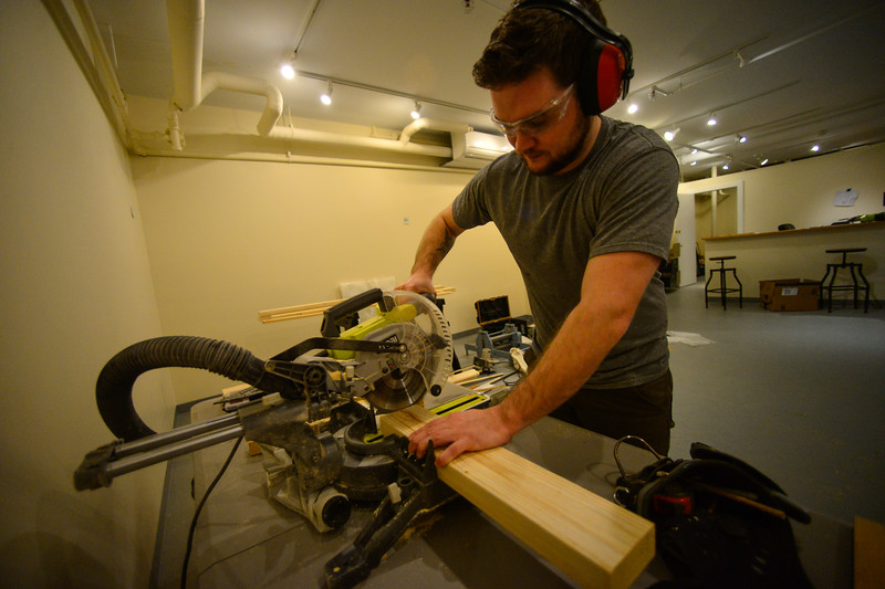 KRISTOPHER RADDER — BRATTLEBORO REFORMER<br /> Daniel Chiaccio, the owner of First Proof Press, uses a saw as he works on making tables that people can use to make their own print projects inside his workshop studio space.