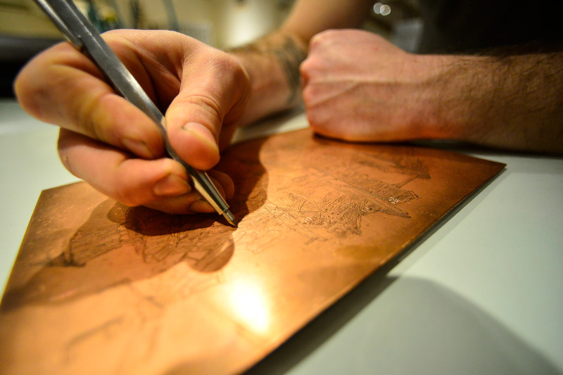 KRISTOPHER RADDER — BRATTLEBORO REFORMER<br /> Daniel Chiaccio, the owner of First Proof Press, uses a sharp tool to fix a template.