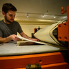 KRISTOPHER RADDER — BRATTLEBORO REFORMER<br /> Daniel Chiaccio, the owner of First Proof Press, puts the inked template through the press.