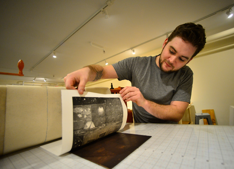 KRISTOPHER RADDER — BRATTLEBORO REFORMER<br /> Daniel Chiaccio, the owner of First Proof Press, slowly lifts up the paper to reveal the design after running through the press.