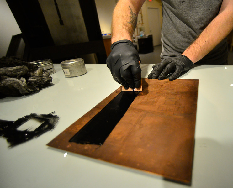 KRISTOPHER RADDER — BRATTLEBORO REFORMER<br /> Daniel Chiaccio, the owner of First Proof Press, spreads black ink onto a template before putting it through a press on Monday, Feb. 3, 2020.