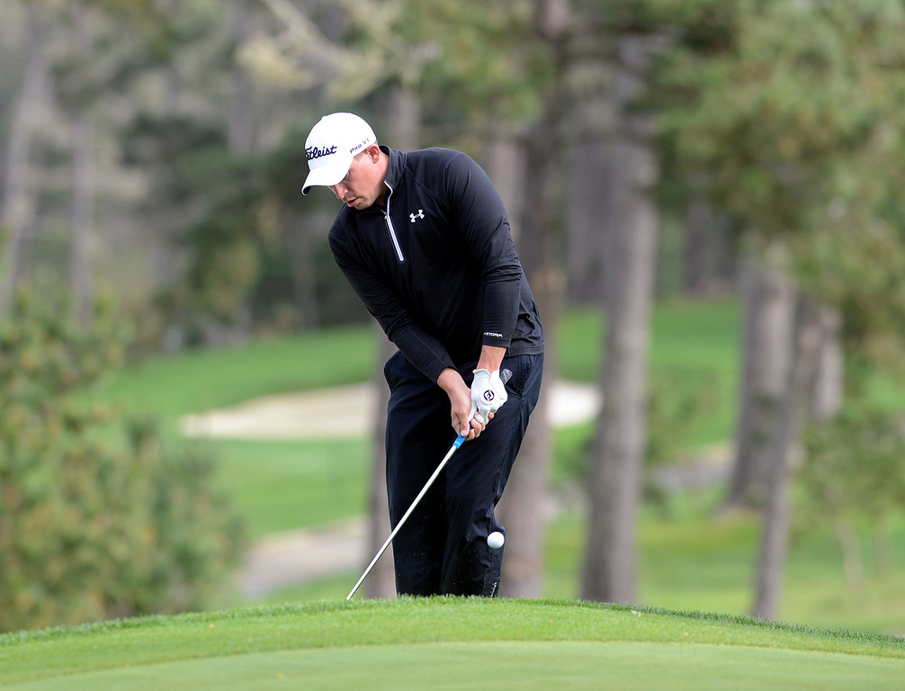 . Scott Stallings chips his ball onto the 18th green at Spyglass Hill Golf Course during the AT&T Pebble Beach Pro-AM in Pebble Beach on Thursday February 9, 2017. (David Royal - Monterey Herald)
