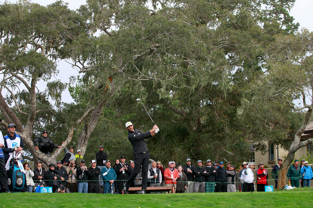 . Dustin Johnson hits his tee shot on the third hole at Monterey Peninsula Country Club during the first round of the AT&T Pebble Beach Pro Am on Thursday, Feb. 9, 2017.   (Vern Fisher - Monterey Herald)