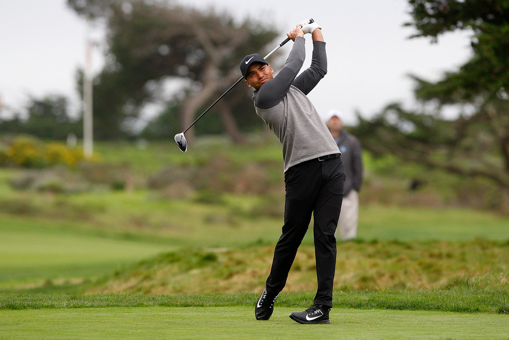 . Jason Day watches his tee shot on the 17th hole at Monterey Peninsula Country Club during the first round of the AT&T Pebble Beach Pro Am on Thursday, Feb. 9, 2017.   (Vern Fisher - Monterey Herald)