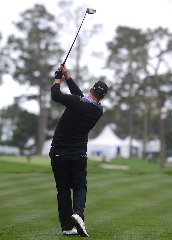 . Michael Putnam hits his tee shot on the 18th hole at Spyglass Hill Golf Course during the AT&T Pebble Beach Pro-AM in Pebble Beach on Thursday February 9, 2017. (David Royal - Monterey Herald)