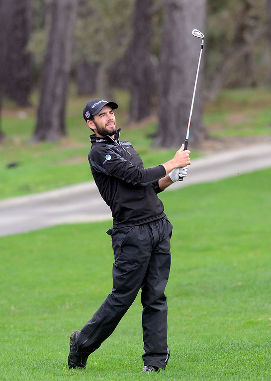 . Troy Merritt knocks his ball from off course and onto the 17th green at Spyglass Hill Golf Course during the AT&T Pebble Beach Pro-AM in Pebble Beach on Thursday February 9, 2017. (David Royal - Monterey Herald)