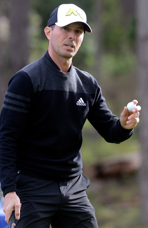 . Mike Weir waves to fans after sinking a birdyon the 17th green at Spyglass Hill Golf Course during the AT&T Pebble Beach Pro-AM in Pebble Beach on Thursday February 9, 2017. (David Royal - Monterey Herald)