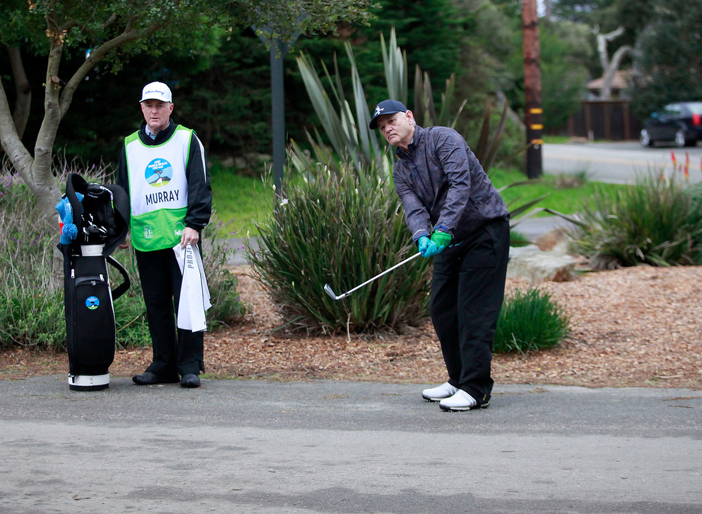 . Bill Murray hits his third shot from the road on the first hole at Monterey Peninsula Country Club during the first round of the AT&T Pebble Beach Pro Am on Thursday, Feb. 9, 2017.   (Vern Fisher - Monterey Herald)