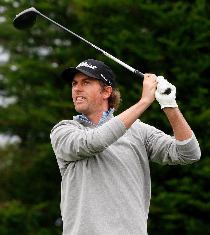 . Webb Simpson watches his tee shot on the second hole at Monterey Peninsula Country Club during the first round of the AT&T Pebble Beach Pro Am on Thursday, Feb. 9, 2017.   (Vern Fisher - Monterey Herald)
