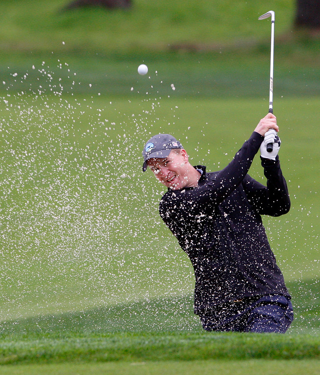 . Peyton Manning hits from a bunker on the first hole at Monterey Peninsula Country Club during the first round of the AT&T Pebble Beach Pro Am on Thursday, Feb. 9, 2017.   (Vern Fisher - Monterey Herald)
