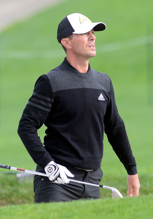 . Mike Weir checks his shot from a trap on the 18th green at Spyglass Hill Golf Course during the AT&T Pebble Beach Pro-AM in Pebble Beach on Thursday February 9, 2017. (David Royal - Monterey Herald)