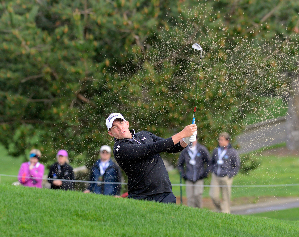 . Scott Stallings knocks his ball from a trap on the 17th fairway at Spyglass Hill Golf Course during the AT&T Pebble Beach Pro-AM in Pebble Beach on Thursday February 9, 2017. (David Royal - Monterey Herald)