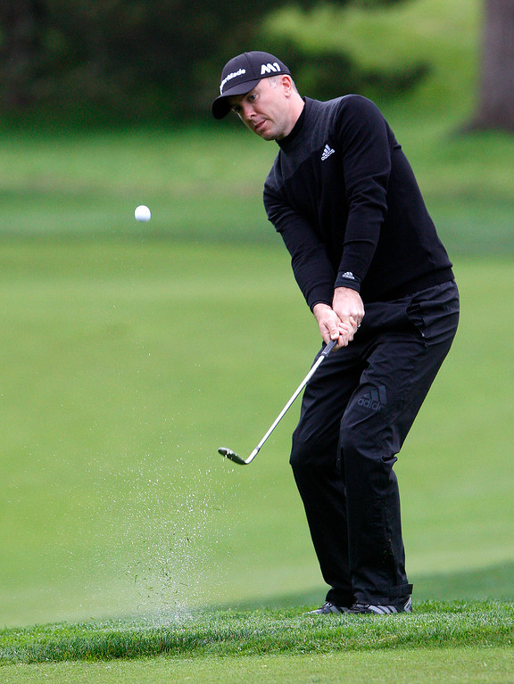 . Martin Laird chips in for an birdie on the first hole at Monterey Peninsula Country Club during the first round of the AT&T Pebble Beach Pro Am on Thursday, Feb. 9, 2017.   (Vern Fisher - Monterey Herald)