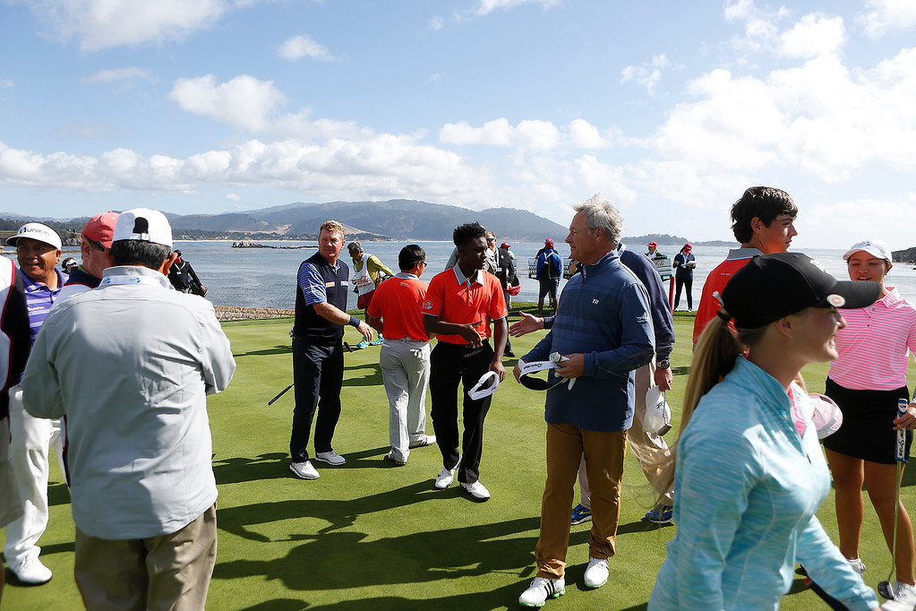 . PGA players and junior players shake hands on the 18th green during the The First Tee Coca-Cola Champions Challenge at Pebble Beach Golf Links on Thursday September 21, 2017. Teams competed for a $40,000 charity purse playing a modified Scotch, alternate-shot format on holes 1, 2, 3, 17 and 18. (David Royal/Herald Correspondent)
