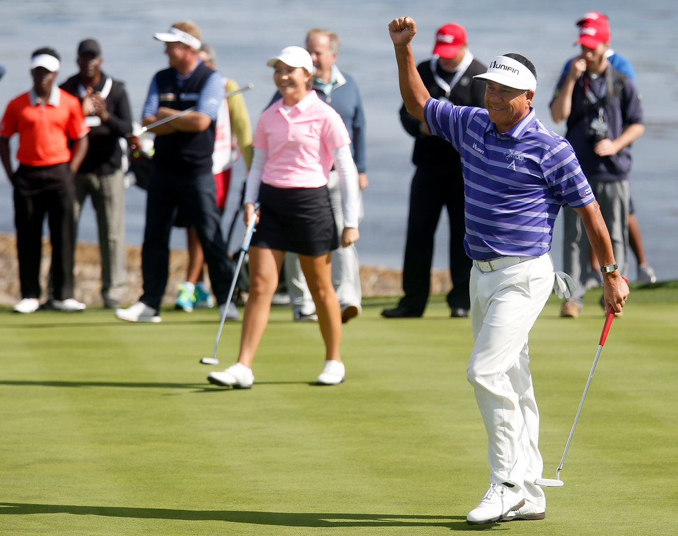 . PGA player Esteban Toledo and his junior player partner Sienna Lyford, center left, react after he sank his putt to win the 18th hole during The First Tee during the Coca-Cola Champions Challenge at Pebble Beach Golf Links  on Thursday September 21, 2017. Teams competed for a $40,000 charity purse playing a modified Scotch, alternate-shot format on holes 1, 2, 3, 17 and 18. (David Royal/Herald Correspondent)