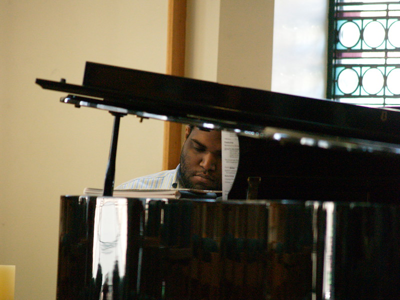 Philip Morgan, Music Director, playing piano during service.