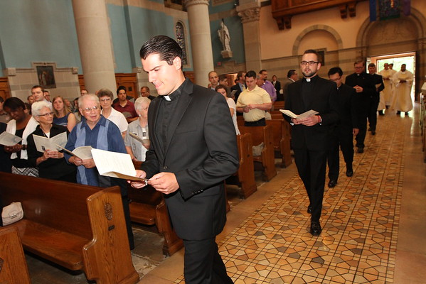 Seven Midwest Jesuits professed First Vows in the Society of Jesus on Saturday, August 8, 2015 at Saint Thomas More Catholic Church in Saint Paul, Minn. They are Sean Barry, Lawrence Ryen Dwyer, Patrick Hyland, Matthew Ippel, Minh-Hoang Le, Bryan Paulsen, and Emanuel Werner. Father Brian Paulson, SJ, Provincial of the Chicago-Detroit Province, presided at the Mass, and Fr. Thomas Lawler, SJ, Provincial of the Wisconsin Province, served as homilist.